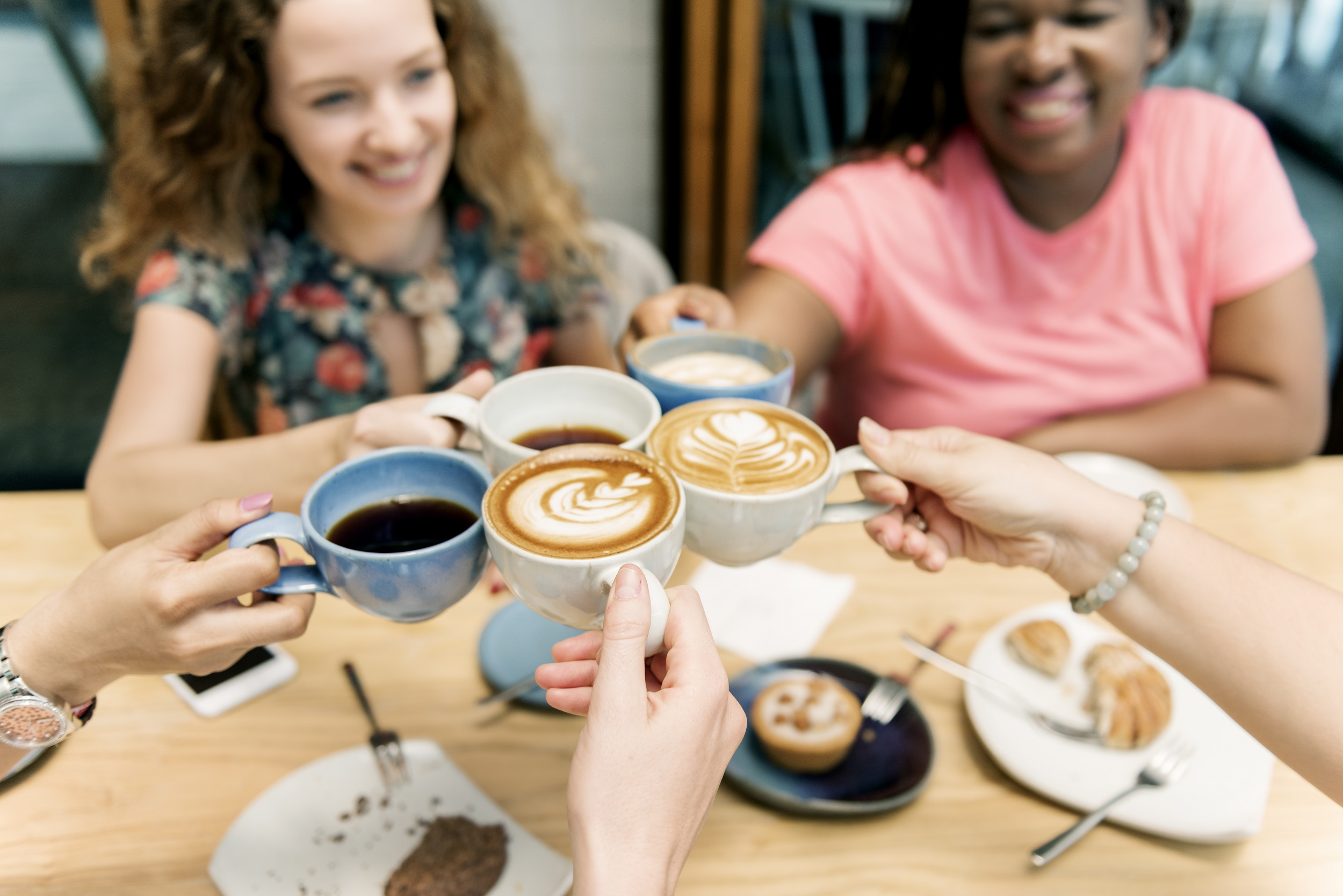 Young Women Drinking Coffee Concept